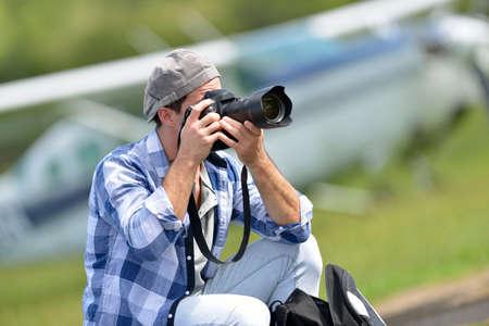 aerodrome: Young photographer taking picture in aerodrome