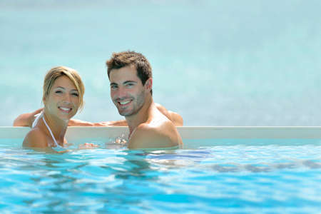 infinity pool: Couple swimming in infinity pool