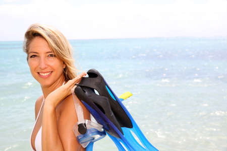 Cheerful woman with snorkeling outfit photo