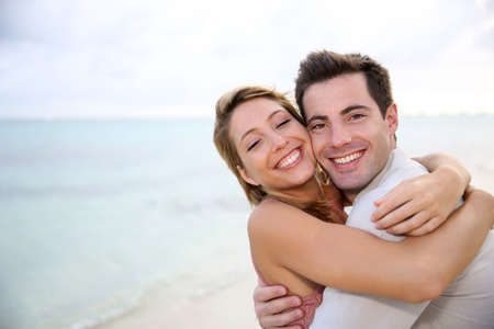 sweet love: In love couple embracing by the beach Stock Photo