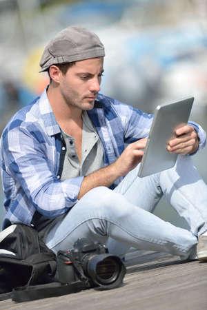 globetrotter: Globe-trotter using digital tablet during journey