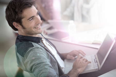 Student in campus relaxing with laptop  Stock Photo