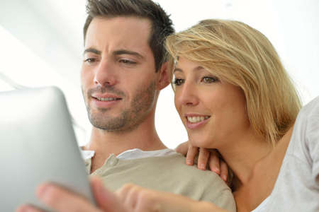 websurfing: Couple websurfing on internet with tablet Stock Photo