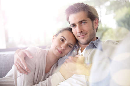 Couple at home relaxing in sofa