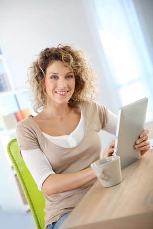 Woman in homr-office using tablet photo