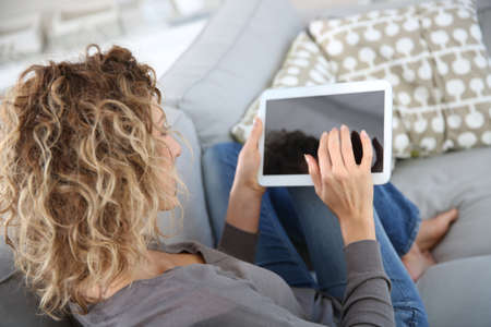 Back view of woman using digital tablet photo