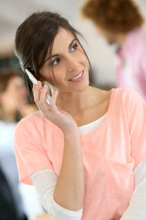 officeworker: Office-worker talking on mobile phone Stock Photo