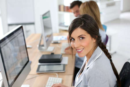 Smiling beautiful woman working in office photo