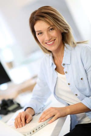 35 years old: Smiling businesswoman working in office