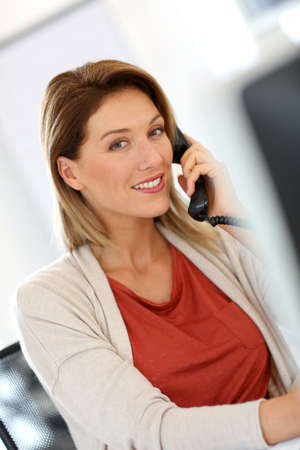 prospection: Businesswoman in office talking on the phone Stock Photo