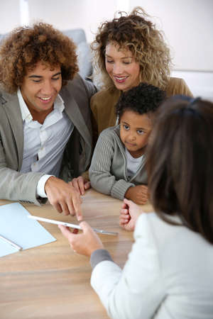 realestate: Family meeting real-estate agent for home purchase Stock Photo
