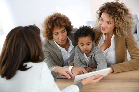 Family meeting real-estate agent for home purchase Stock Photo