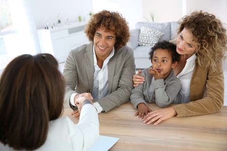 buyers: Family meeting real-estate agent for home purchase Stock Photo