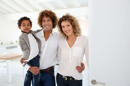 5 years: Happy family welcoming people in new home Stock Photo
