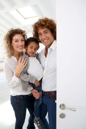 welcome door: Happy family welcoming people in new home Stock Photo