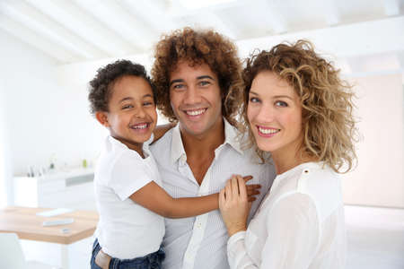Happy family standing in brand new home Stock Photo