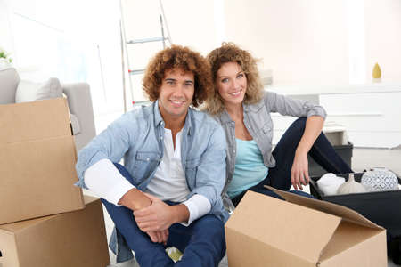 getting together: Couple getting in their new apartment to live together