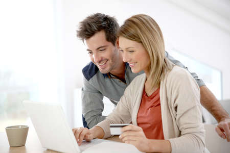 payment: Couple at home buying on internet Stock Photo