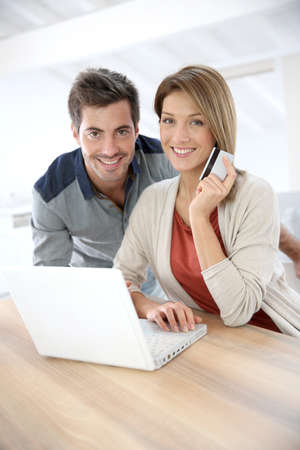Couple at home doing online shopping photo