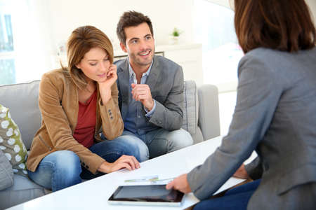 planner: Couple meeting financial adviser for real estate project Stock Photo
