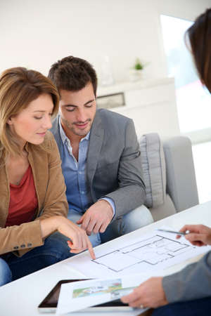 Couple meeting architect for house construction photo