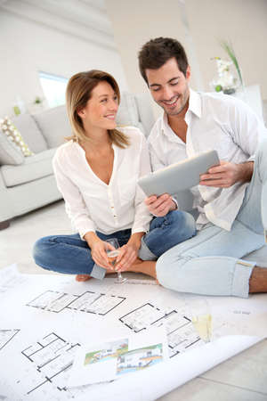 home construction: Couple at home celebrating new house purchase