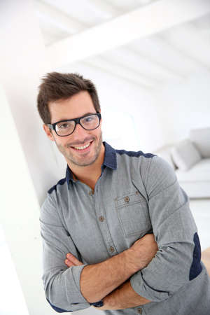 Cheerful handsome man with eyeglasses photo