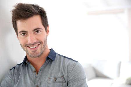 Smiling handsome man looking at camera Imagens