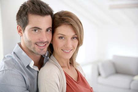 Couple standing in contemporary home photo