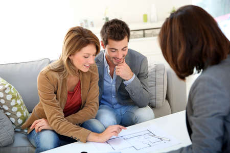 building planners: Couple meeting architect for house construction