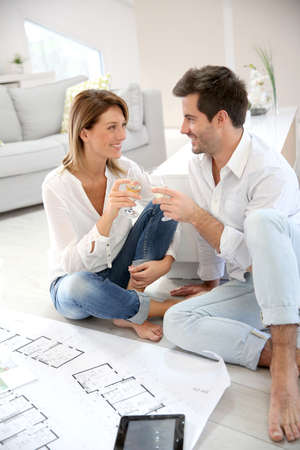 champain: Couple at home celebrating new house purchase