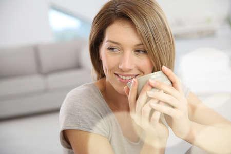 woman drinking tea: Beautiful woman drinking hot tea