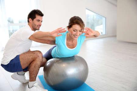 pilates man: Woman doing pilates exercises with coach