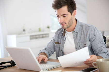 working from home: Man working from home with laptop