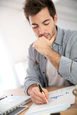 working from home: Salesman working from home on budget Stock Photo