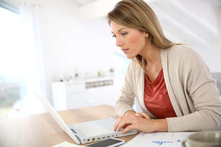 Businesswoman working from home in laptop computer photo