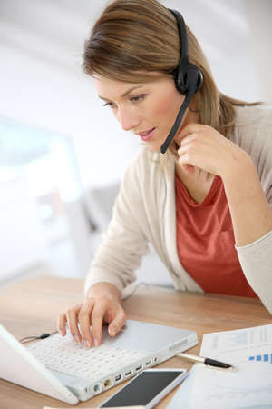 Businesswoman attending video conference from home photo