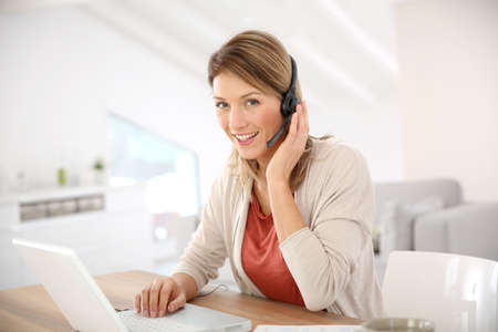 conference call: Businesswoman attending video conference from home