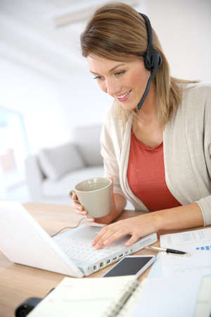 prospection: Businesswoman attending video conference from home
