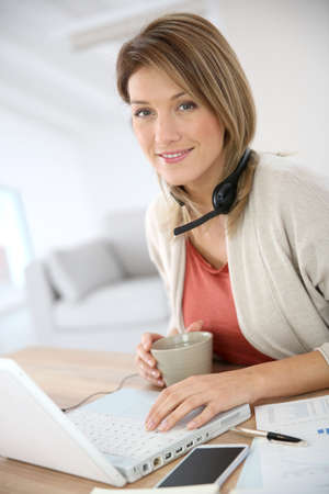 working from home: Businesswoman working from home in laptop computer Stock Photo