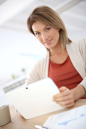 working from home: Woman working from home on digital tablet
