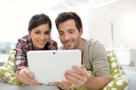 Couple at home websurfing on internet photo