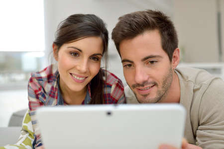 websurfing: Couple at home websurfing on internet
