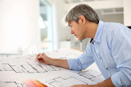 architect drawing: Architect designing house for client Stock Photo