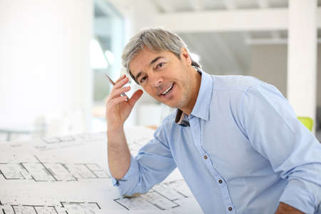 architect office: Portrait of smiling architect working in office