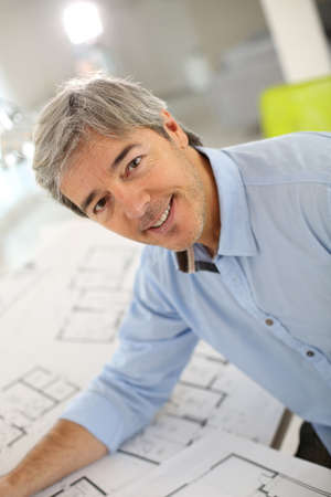 Portrait of smiling architect working in office photo