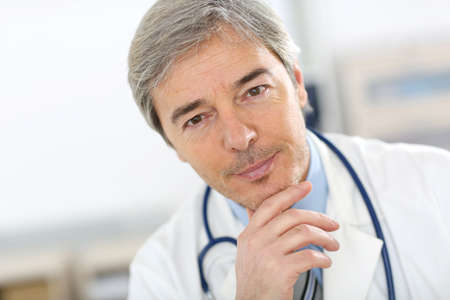 medicalcare: Portrait of attractive senior doctor Stock Photo