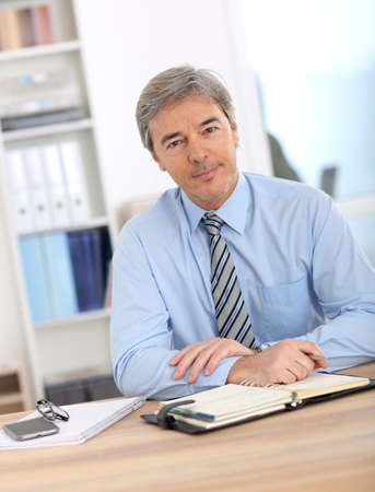 Portrait of mature businessman in office photo