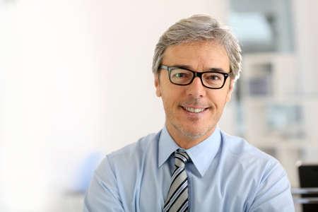Portrait of senior businessman with eyeglasses