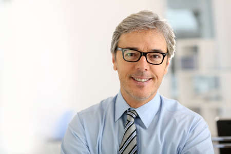 managers: Portrait of senior businessman with eyeglasses